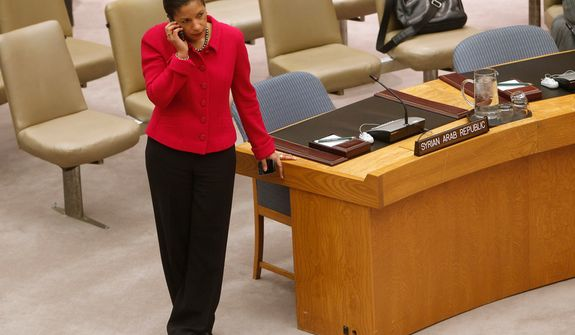 Susan Rice, U.S. ambassador to the United Nations, leans near Syria's desk space as she takes a call before voting on a draft resolution backing an Arab League call for Syrian President Bashar Assad to step down, which was vetoed by Russia and China, during a meeting of the U.N. Security Council at the world body's headquarters on Saturday, Feb. 4, 2012. The unusual weekend session came as Syrian forces pummeled the city of Homs with mortars and artillery in what activists are calling one of the bloodiest episodes of the uprising. (AP Photo/Jason DeCrow)