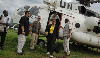 "In this photo released by the United Nations Mission in Sudan (UNMIS), U.N. Security Council delegation members Susan Rice (center), U.S. ambassador to the United Nations, and Nestor Osorio (leaving helicopter) of Columbia arrive in Malau, Sudan, on Tuesday, May 24, 2011. Seventy northern Sudanese troops were killed and more than 120 are missing from an attack last week by southern Sudanese forces near the disputed region of Abyei, a Sudanese diplomat said Tuesday, while Ms. Rice called the incident a ""serious violation"" of the peace agreement. (AP Photo/UNMIS, Paul Banks)"