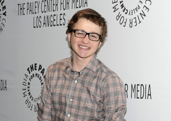 "** FILE ** Actor Angus T. Jones arrives at the ""Paleyfest"" panel discussion on the television series ""Two and a Half Men"" in Beverly Hills, Calif., on Monday, March 12, 2012. Mr. Jones, a 19-year-old who plays the ""half"" on the hit series, says the show is ""filth"" and, through a video posted by a Christian church, has urged viewers not to watch"