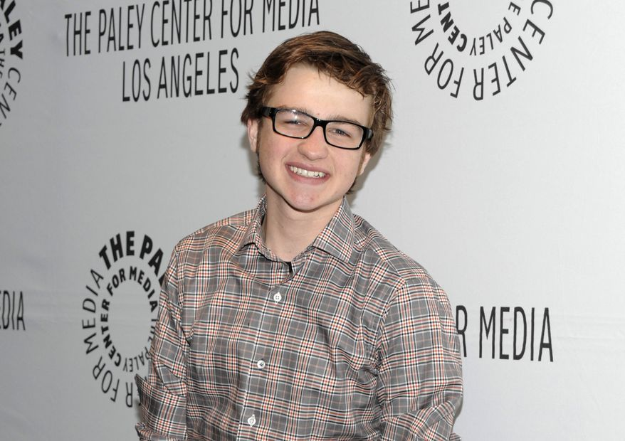 "** FILE ** Actor Angus T. Jones arrives at the ""Paleyfest"" panel discussion on the television series ""Two and a Half Men"" in Beverly Hills, Calif., on Monday, March 12, 2012. Mr. Jones, a 19-year-old who plays the ""half"" on the hit series, says the show is ""filth"" and, through a video posted by a Christian church, has urged viewers not to watch it. (AP Photo/Dan Steinberg)"