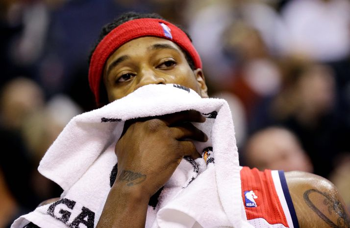 Washington Wizards forward Cartier Martin watches from the bench in the second half of an NBA basketball game against the San Antonio Spurs Monday, Nov. 26, 2012, in Washington. The Spurs won 118-92. The Wizards are now 0-12. (AP Photo/Alex Brandon)