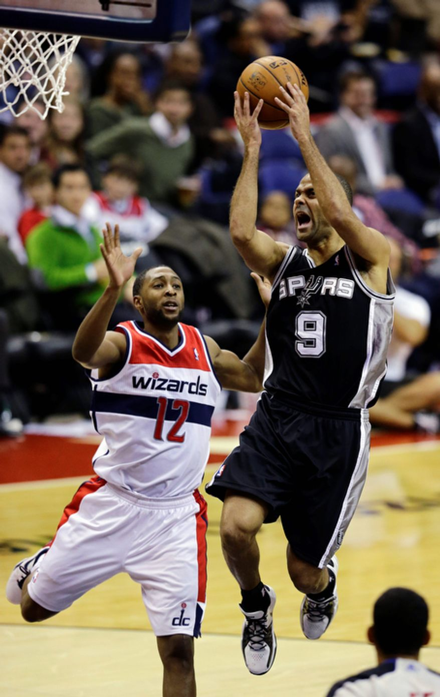 San Antonio Spurs guard Tony Parker shoots past Washington Wizards guard A.J. Price in the second half of an NBA basketball game Monday, Nov. 26, 2012, in Washington. The Spurs won 118-92. The Wizards are now 0-12. (AP Photo/Alex Brandon)