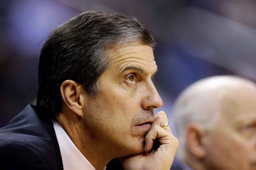 Washington Wizards head coach Randy Wittman watches his team in the second half of an NBA basketball game against the San Antonio Spurs, Monday, Nov. 26, 2012, in Washington. The Spurs won 118-92. (AP Photo/Alex Brandon)
