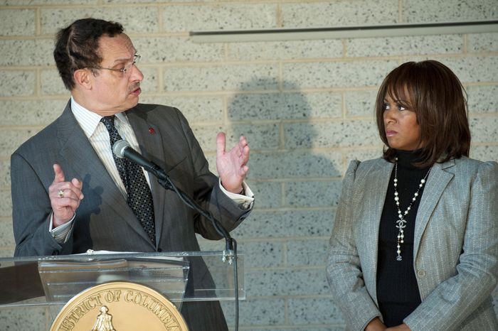 During his biweekly press briefing Wednesday, D.C. Mayor Vincent C. Gray and state schools superintendent Hosanna Mahaley talk about how a 4-year-old special-needs student was left alone on a school bus for several hours Tuesday. (Rod Lamkey Jr./The Washington Times)