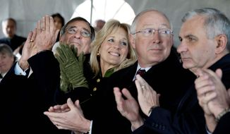 At the Vietnam Veterans Memorial on Wednesday, (from left) Defense Secretary Leon E. Panetta, Jill Biden, Interior Secretary Kenneth L. Salazar and Sen. Jack Reed applaud during a groundbreaking ceremony for an education center that will tell the stories of generations of veterans killed in combat. (Associated Press)