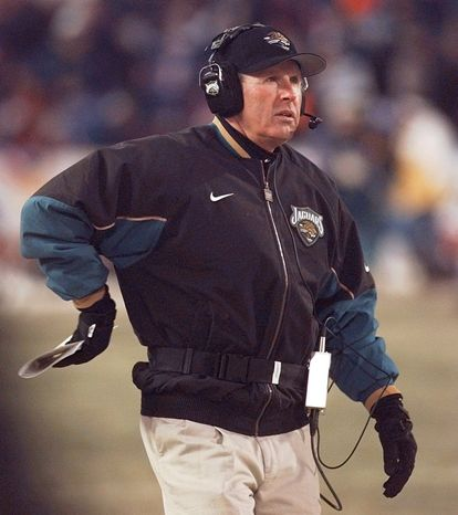 Tom Coughlin (then coach of the Jacksonville Jaguars) looks on from the sidelines as his team plays the New England Patriots in the  AFC Championship game at Foxboro Stadium in Foxboro, Mass., Sunday January 12, 1997. (AP Photo/Doug Mills)