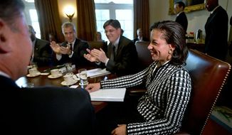 UN Ambassador Susan Rice, right, smiles as she is applauded, as President Obama says what an excellent job she has been doing, before meeting with his cabinet, Wednesday, Nov. 28, 2012, in the Cabinet Room of the White House in Washington. Earlier, Rice continued her fight on Capitol Hill to win over skeptics in the Senate who could block her chances at becoming the next U.S. secretary of state. (AP Photo/Jacquelyn Martin)