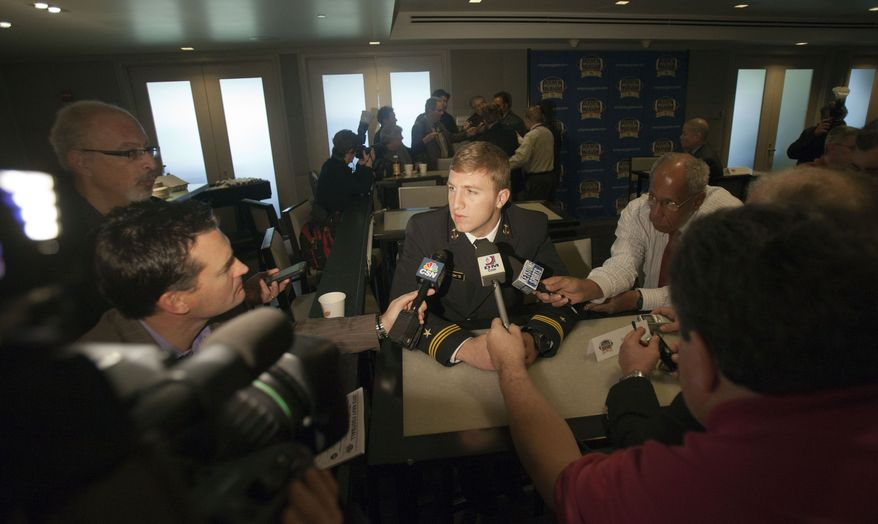 Navy football player Brye French, center, speaks with reporters during a media luncheon on Wednesday, Nov. 28, 2012 in Philadelphia. The Army and Navy NCAA college football game is scheduled to be played on Saturday, Dec. 8. (AP Photo/Jessica Kourkounis)