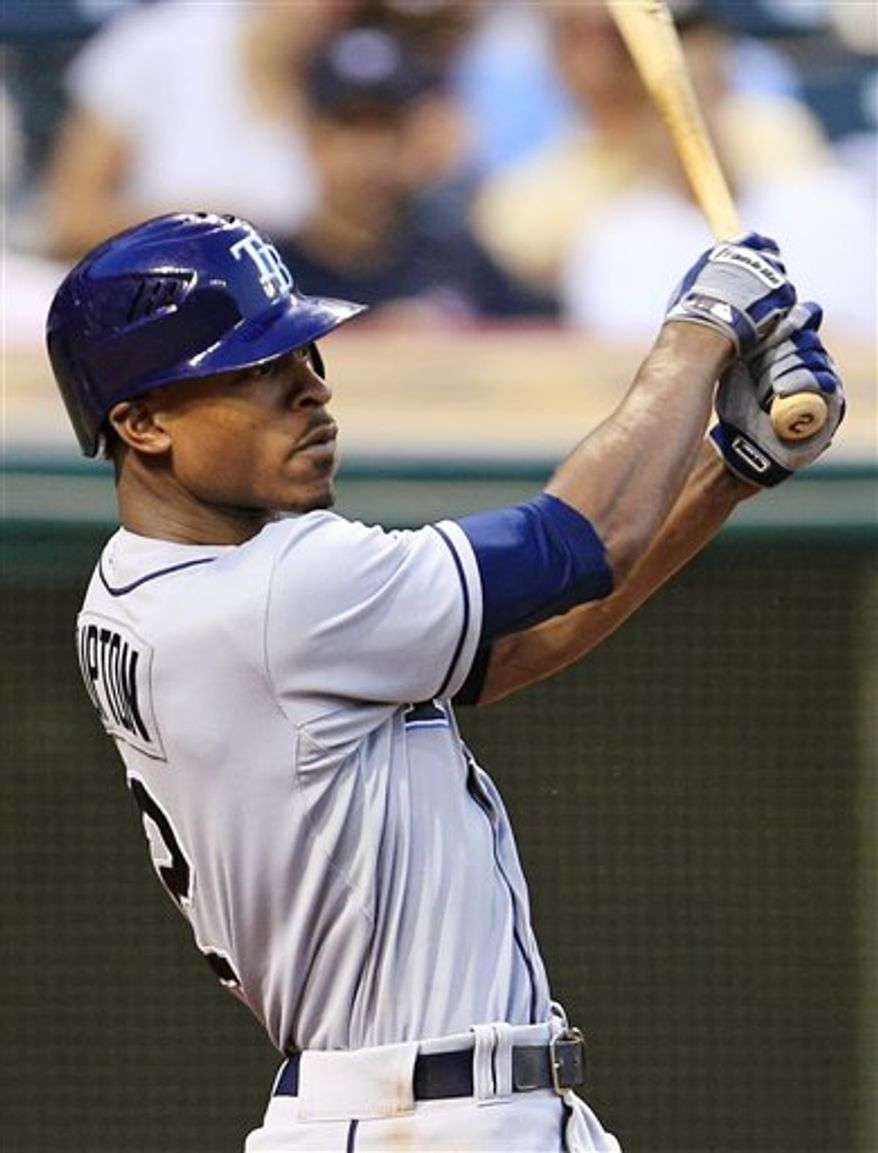 ** FILE ** In this July 6, 2012, photo, Tampa Bay Rays' B.J. Upton hits against the Cleveland Indians in Cleveland. A person familiar with the deal told The Associated Press Wednesday, Nov. 28, the Atlanta Braves have reached an agreement on a five-year deal with Upton. (AP Photo/Tony Dejak, File)