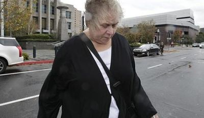 Former Democratic campaign treasurer Kinde Durkee leaves the federal courthouse in Sacramento, Calif., after she was sentenced to more than eight years in federal prison for defrauding high-profile clients, such as U.S. Sen. Dianne Feinstein, Wednesday, Nov. 28, 2012. Durkee, who pleaded guilty to five counts of mail fraud in March, was sentenced to a total of 97 months and was ordered to pay $10.5 million in restitution for tampering with the electoral process. (AP Photo/Rich Pedroncelli)