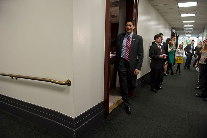 Rep. Paul Ryan (R-Wisc.) leaves a room at the U.S. Capitol where he and other Republican House leadership members met Wednesday, Nov. 28, 2012 to discuss the fiscal cliff. (Barbara L