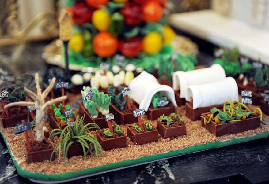 The White House vegetable garden is replicated as part of the nearly 300-pound gingerbread house of the White House, on display in the State Dining Room of the White House in Washington.  The White House gingerbread house has been a tradition since the 1960s. (AP Photo/Susan Walsh)