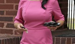 Socialite Jill Kelley leaves her home in Tampa, Fla., on Tuesday, Nov. 13, 2012. (AP Photo/Chris O'Meara)