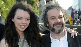 "Director Peter Jackson, right, poses with his daughter Katie on the red carpet at the premiere of his new film ""The Hobbit: An Unexpected Journey,"" at the Embassy Theatre, in Wellington, New Zealand, Wednesday, Nov. 28, 2012. (AP Photo/SNPA, Ross Setford)"