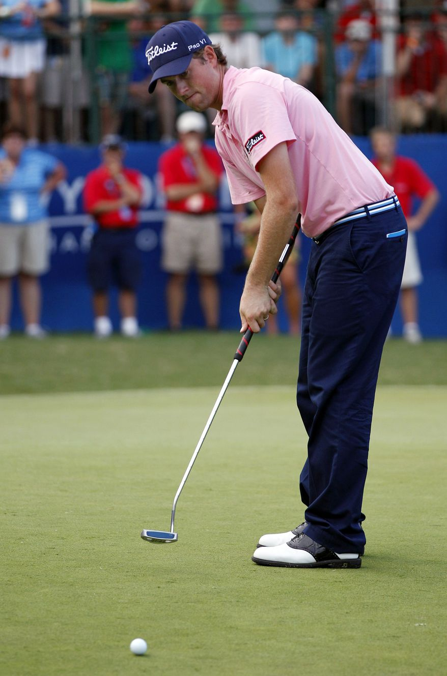 FILE - In this Aug. 20, 2011, file photo,Webb Simpson putts on the 18th hole during the third round of the Wyndham Championship golf tournament in Greensboro, N.C. Webb Simpson and Keegan Bradley, two of the major faces in the debate over belly putters, said Tuesday, Nov. 27, 2012, they would not fight a change in the rules if golf's governing bodies decide to outlaw putters anchored to the body. (AP Photo/Chuck Burton, File)