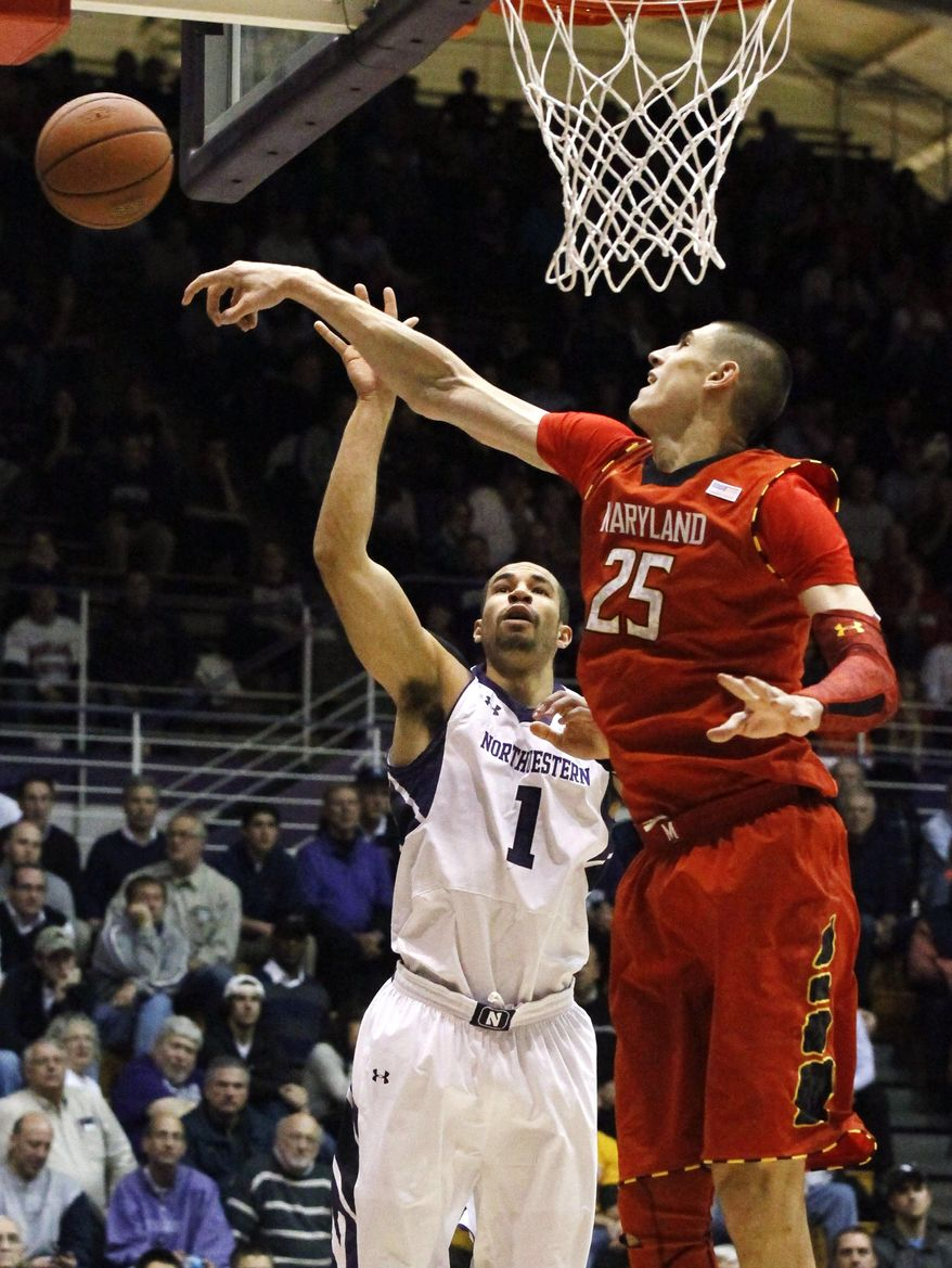 Maryland center Alex Len (25) blocks the shot of Northwestern forward Drew Crawford during the second half of an NCAA college basketball game, Tuesday, Nov. 27, 2012, in Evanston, Ill. Maryland won 77-57. (AP Photo/Charles Rex Arbogast)