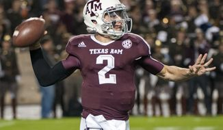 Texas A&M quarterback Johnny Manziel passes during the first quarter of an NCAA college football game against Missouri, Saturday, Nov. 24, 2012, in College Station, Texas. A&M defeated Missouri 59-29. (AP Photo/Dave Einsel)