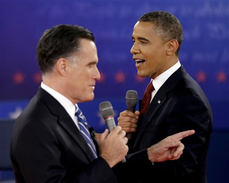 **FILE** President Obama (right) and Republican presidential candidate and former Massachusetts Gov. Mitt Romney exchange views during the second presidential debate at Hofstra University in Hempstead, N.Y., on Oct. 16, 2012. (Associated Press)