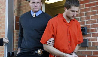Micah Moore (right), 23, is escorted into the Jackson County Courthouse Annex in Independence, Mo., on Tuesday, Nov. 13, 2012. He is charged with first-degree murder in the death of 27-year-old Bethany Deaton and is scheduled for a preliminary hearing on Wednesday, Nov. 28, 2012. (AP Photo/The Kansas City Star, Keith Myers)