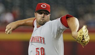 FILE - This Aug. 27, 2012 file photo shows Cincinnati Reds' Jonathan Broxton throwing against the Arizona Diamondbacks during a baseball game in Phoenix. The Reds have signed Broxton to a three-year, $21 million contract, giving the NL Central champions a potential closer. (AP Photo/Ross D. Franklin, File)
