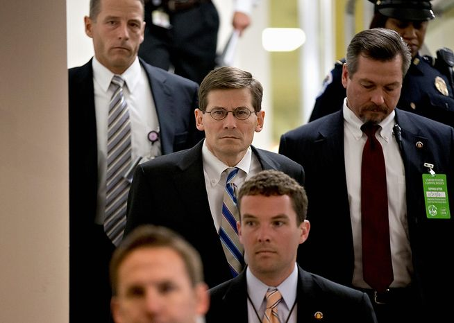 Acting CIA Director Michael Morell, center, arrives on Capitol Hill in Washington, Tuesday, Nov. 27, 2012,  for a closed-door meeting with UN Ambassador Susan Rice who could find her name in contention as early as this week to succeed Hillary Rodham Clinton as secretary of state. Rice has been criticized by some GOP se