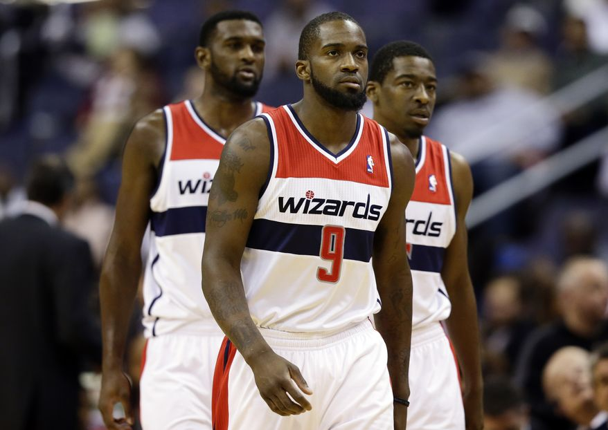 Washington Wizards small forward Chris Singleton, left, small forward Martell Webster and shooting guard Jordan Crawford walk on the court after a break in the first half of an NBA basketball game against the San Antonio Spurs Monday, Nov. 26, 2012, in Washington.(AP Photo/Alex Brandon)