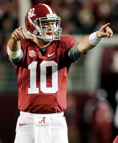 AJ McCarron is 23-2 as the starting quarterback for Alabama entering the SEC championship game Saturday. His Georgia counterpart, Aaron Murray, is the highest-rated quarterback in the country. (Associated Press)