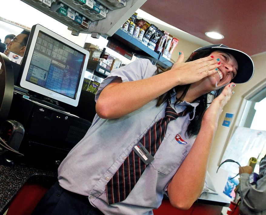 Tanice Stefanich, a cashier at the 4 Sons Food Store in Fountain Hills, Ariz., reacts Thursday to all the attention of shoppers and the media resulting from the sale of one of two winning Powerball lottery tickets there. The lucky ticket purchaser, yet to come forward, will split a $588 million jackpot. (Associated Press)
