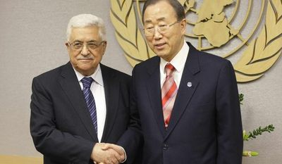 U.N. Secretary General Ban Ki-moon, right, shakes hands with Palestinian President Mahmoud Abbas at U.N. headquarters Wednesday, Nov. 28, 2012. (AP Photo/Frank Franklin II)
