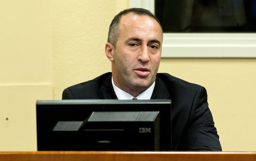 Former Kosovo Prime Minister Ramush Haradinaj awaits his verdict at the courtroom of the Yugoslav war crimes tribunal in The Hague, Netherlands, Thursday, Nov. 29, 2012. (AP Photo/Koen van Weel, Pool)