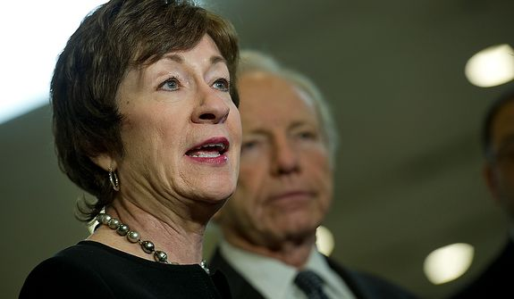 Sens. Susan Collins, left, the ranking member, and Joe Lieberman, chair of the Homeland Security and Governmental Affairs Committee, talk with the media about a briefing their committee was given Thursday, Nov. 29, 2012 about the Benghazi attack. Sen. Lieberman said that they now know more than they did, but they still don't feel like they have all the information. (Barbara L. Salisbury/The Washington Times)