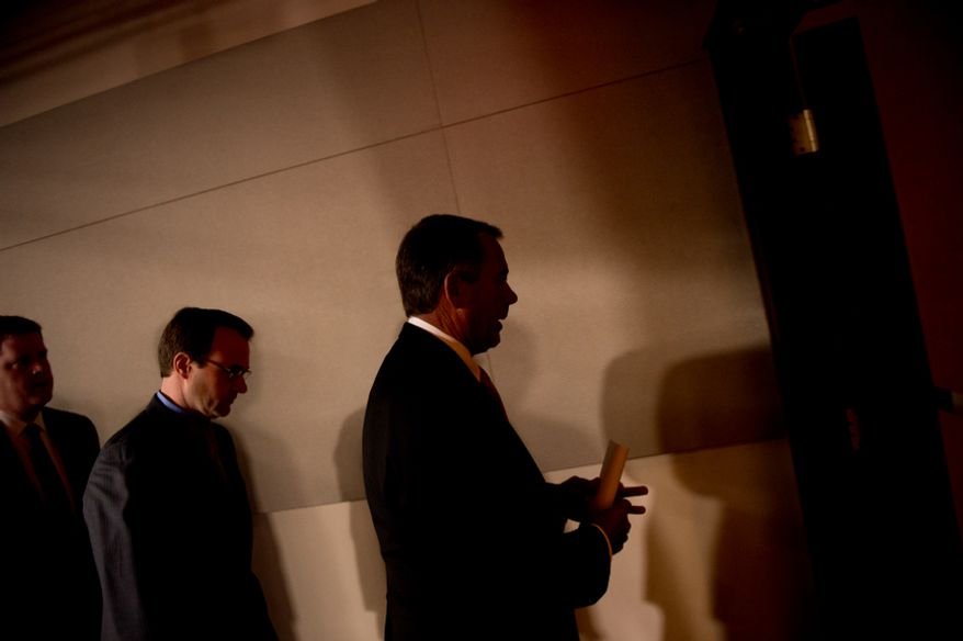 House Speaker John A. Boehner, Ohio Republican, leaves the House Visitors Center at the U.S. Capitol in Washington after speaking to reporters about the looming financial crisis on Thursday, Nov. 29, 2012. (Andrew Harnik/The Washington Times)
