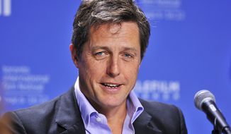 "** FILE ** In this Sept. 9, 2012, file photo, actor Hugh Grant speaks during the news conference for the film ""Cloud Atlas"" during the 2012 Toronto International Film Festival in Toronto. (AP Photo/The Canadian Press, Aaron Vincent Elkaim, File)"