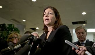 ** FILE ** Sen. Kelly Ayotte, New Hampshire Republican, speaks with reporters after a closed-door meeting with U.N. Ambassador Susan E. Rice about the deadly Sept. 11 raid in Libya, at the Capitol in Washington on Tuesday, Nov. 27, 2012. (AP Photo/J. Scott Applewhite)