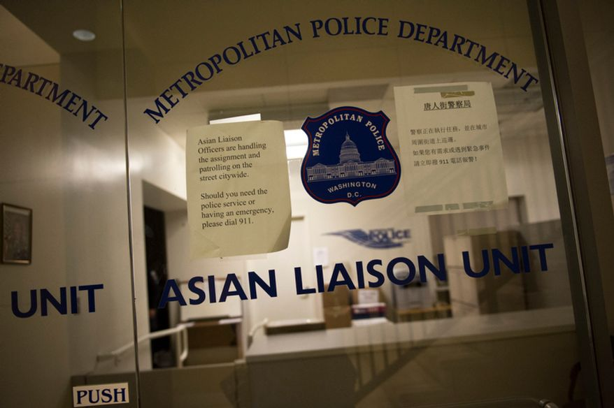 The Metropolitan Police Department's Asian Liaison Unit, pictured on Wednesday, Nov. 28, 2012, is scheduled to be relocated from its current office on H Street Northwest in the heart of Washington's Chinatown. (Rod Lamkey Jr./The Washington Times)