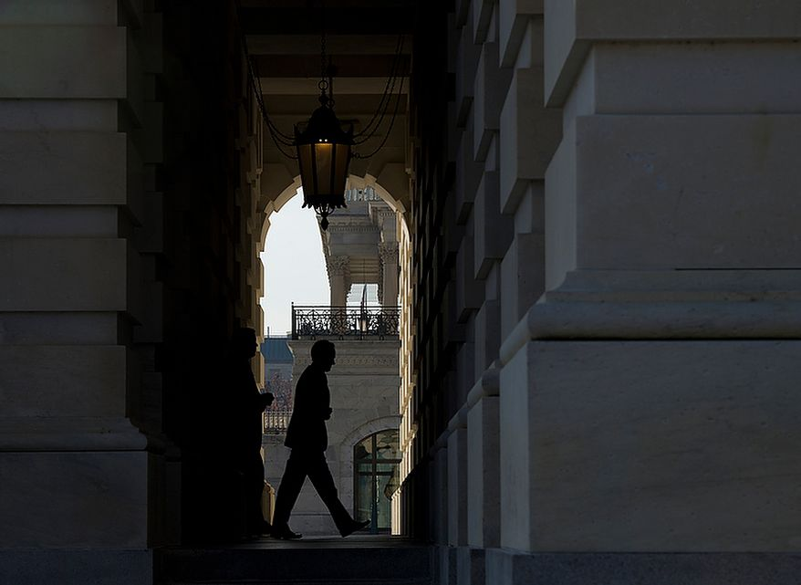 "Treasury Secretary Timothy F. Geithner enters the U.S. Capitol in Washington on Thursday, Nov. 29, 2012, on his way to a meeting with House and Senate leaders to discuss the looming ""fiscal cliff."" (Barbara L. Salisbury/The Washington Times)"
