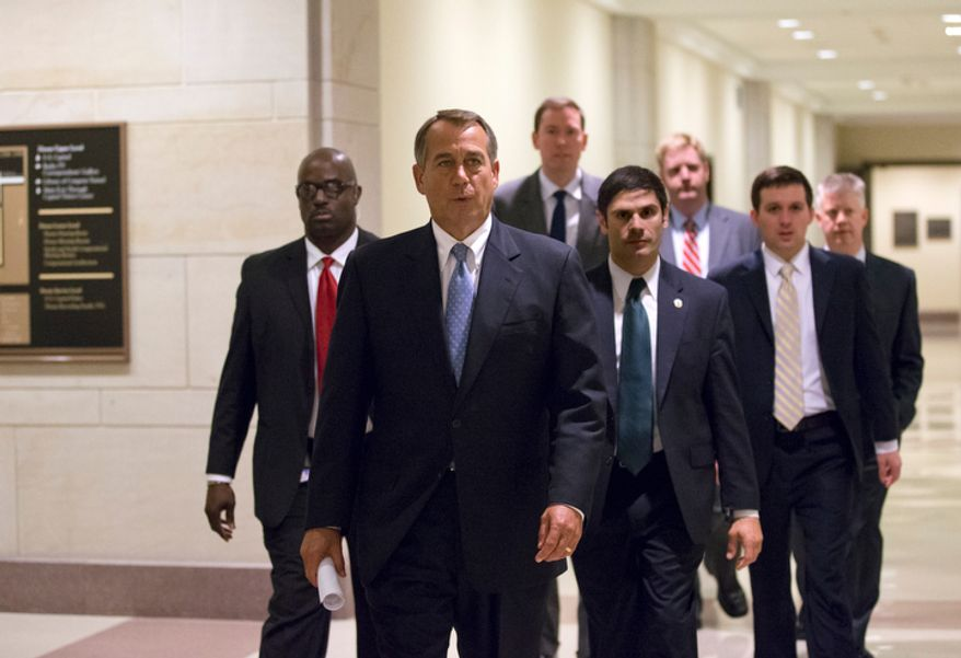 House Speaker John A. Boehner, Ohio Republican, arrives to speak to reporters after House Republicans voted for their leadership for the next session of Congress at the Capitol in Washington on Wednesday, Nov. 14, 2012. (AP Photo/J. Scott Applewhite)