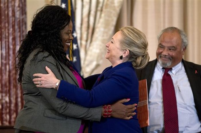 Secretary of State Hillary Rodham Clinton greets Florence Ngobeni-Allen, ambassador for the Elizabeth Glaser Pediatric AIDS Foundation, Thursday, Nov. 29, 2012, during a ceremony in recognition of World AIDS Day, where she released The U.S. President's Emergency Plan for AIDS Relief (PEPFAR) Blueprint for Creating an AIDS- Free Generation. At right US Global AIDS Coordinator Eric P. Goosby. (AP Photo/Jose Luis Magana)