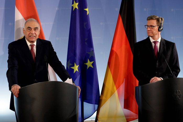 German Foreign Minister Guido Westerwelle, right, and his counterpart from Egypt Kamel Amr, left, address the media during a joint news conference at the Foreign Office in Berlin, Germany, Thursd