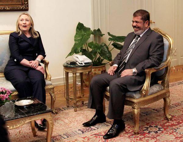 ** FILE ** Secretary of State Hillary Rodham Clinton and Egyptian President Mohammed Morsi laugh during a photo opportunity at their meeting at the pesidential palace in Cairo on Saturday, July 14, 2012. (AP Photo/Maya Alleruzzo)