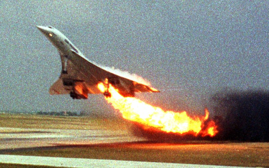 Air France Flight 4590 takes off from Charles de Gaulle Airport outside Paris on July 25, 2000, with fire trailing from an engine on the supersonic Concorde's left wing. (AP Photo/Toshihiko Sato)