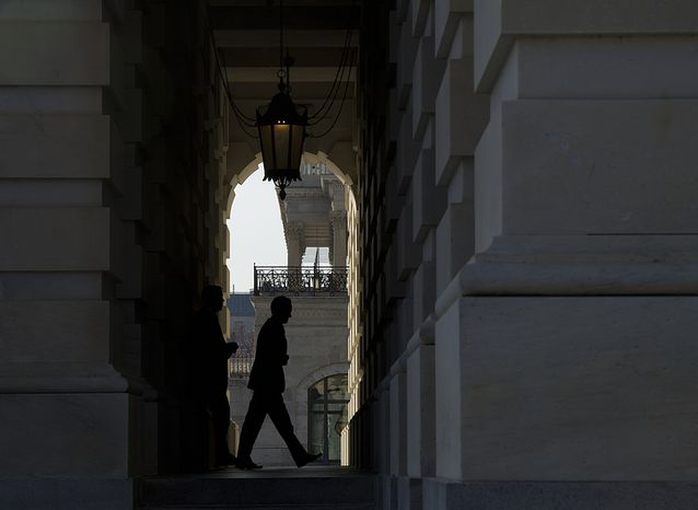 "Treasury Secretary Timothy F. Geithner enters the U.S. Capitol in Washington on Thursday, Nov. 29, 2012. Mr. Geithner is meeting with House and Senate leaders to discuss the looming ""fiscal cliff."" (Barbara L. Salisbury/The Washington Times)"