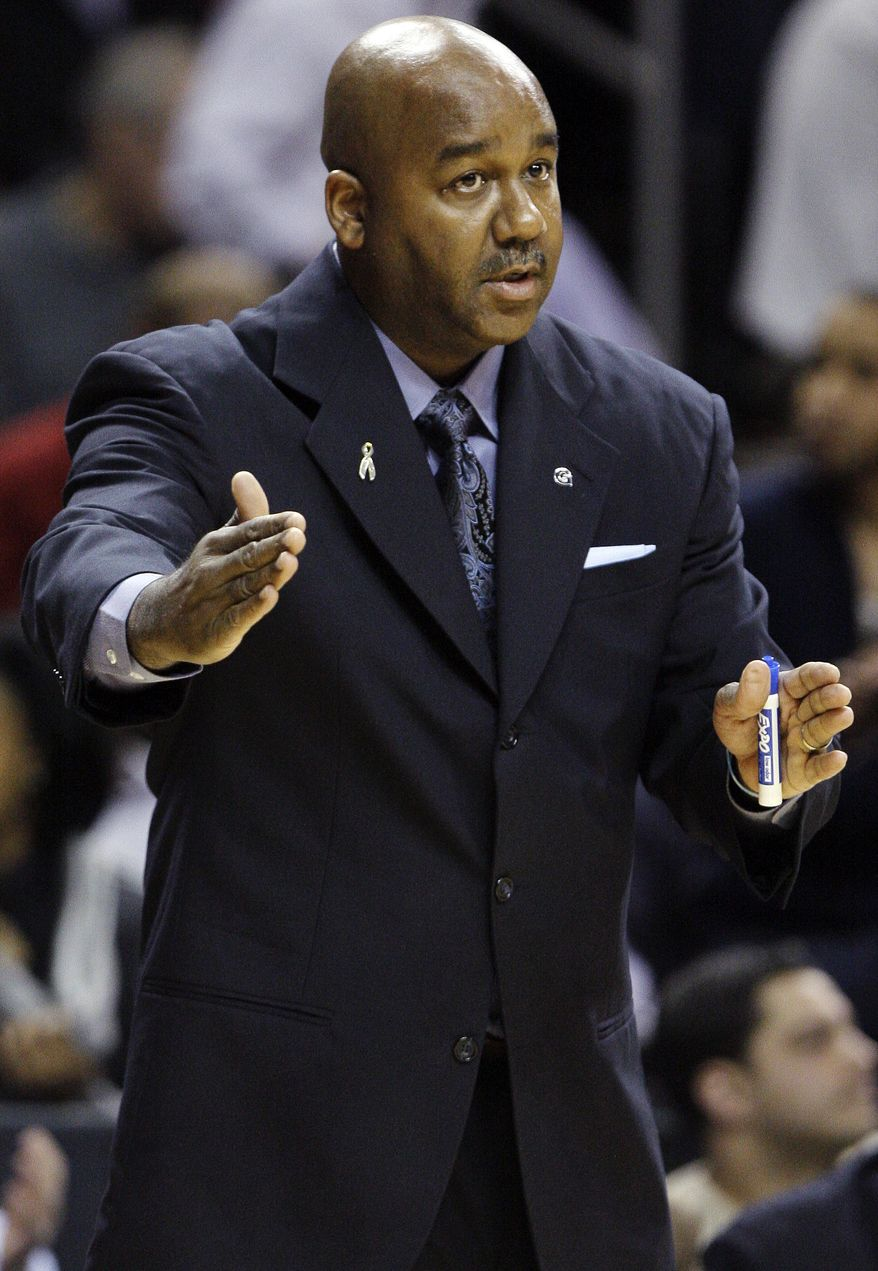 Georgetown head coach John Thompson III instructs his team in the first half of their NCAA college basketball game against UCLA in the Legends Classic, Monday, Nov. 19, 2012, in New York. (AP Photo/Frank Franklin II)