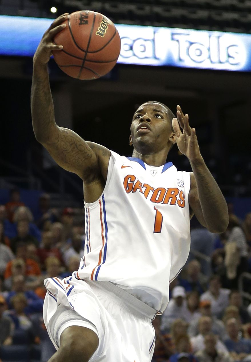 Florida guard Kenny Boynton (1) goes up for two of his 20 points during the second half of an NCAA college basketball game against Middle Tennessee, Sunday, Nov. 18, 2012, in Tampa, Fla. Florida won the game 66-45. (AP Photo/Chris O'Meara)