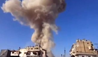 In this image taken from video that has been authenticated based on its contents and other AP reporting, smoke rises from a building after an air attack in Homs, Syria, on Wednesday, Nov. 28, 2012. (AP Photo/Ugarit News via AP video)