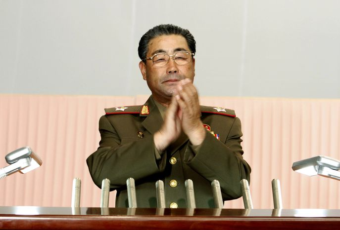 ** FILE ** Then-North Korean Defense Minister Kim Jong-gak applauds during a meeting announcing North Korean leader Kim Jong-un's new title of marshal, at the April 25 House of Culture in Pyongyang, North Korea, on Wednesday, July 18, 2012. Kim Jong-gak has been replaced by Kim K
