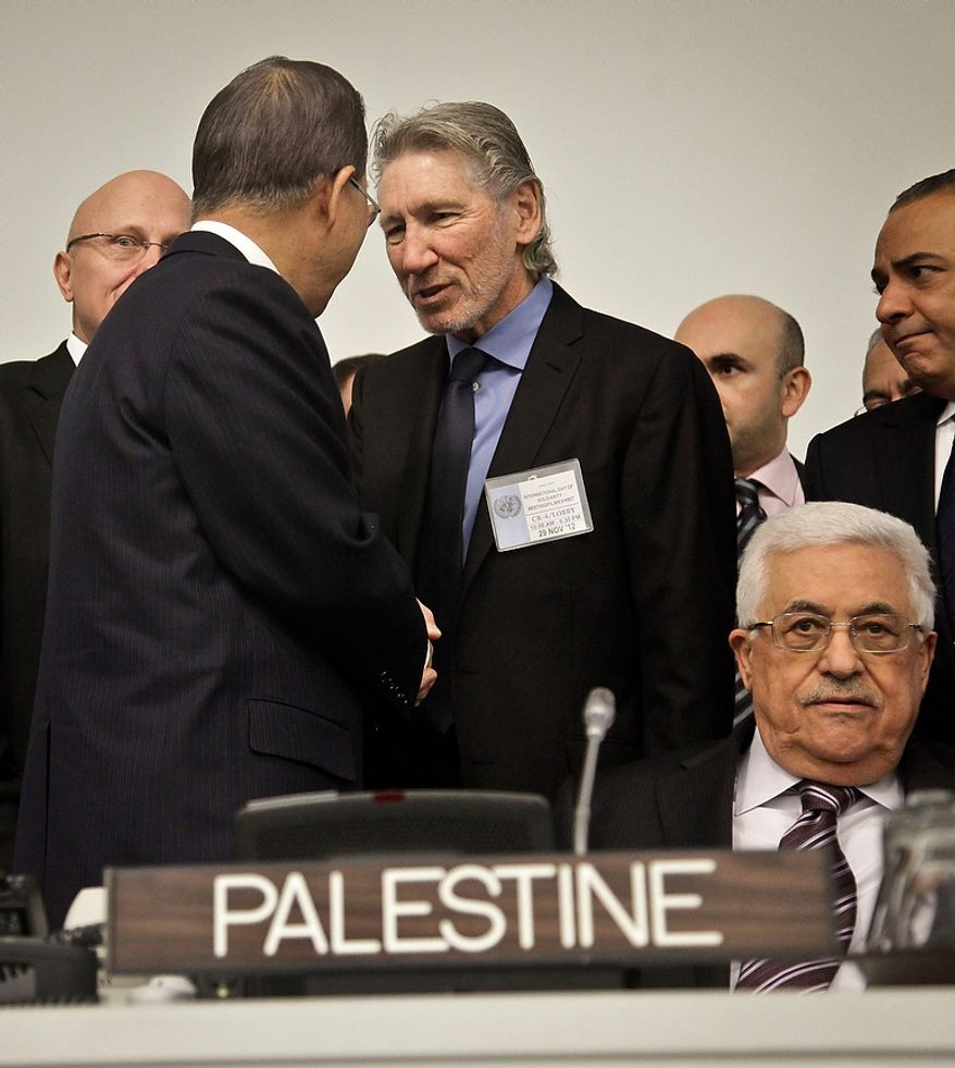 CORRECTS NAME TO  WATERS IN LAST SENTENCE - Roger Waters, center, founding member of Pink Floyd, meets U.N. Secretary-General Ban Ki-moon, while Palestinian President Mahmoud Abbas, second from right, sits waiting for the start of a meeting on Palestine, Thursday, Nov. 29, 2012 in New York.  Palestinians are expected to win U.N. recognition as a state, even as the U.S., Israel's closest ally, mounts an aggressive campaign to head off the General Assembly vote.  Waaters was on a list of speakers at the meeting observing the International Day of Solidarity with the Palestinian People.  (AP Photo/Bebeto Matthews)