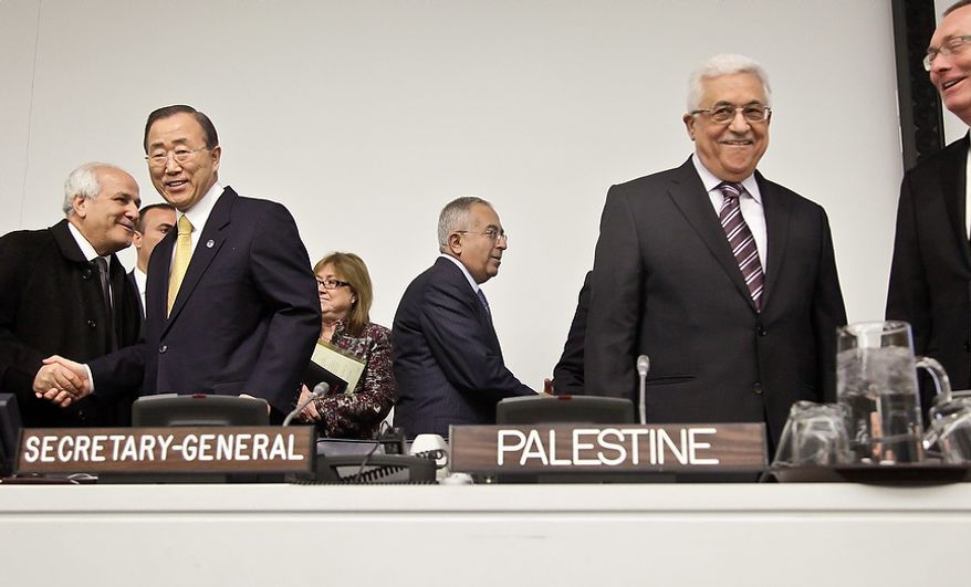 U.N. Secretary-General Ban Ki-moon, second from left, and Palestinian President Mahmoud Abbas, second from right, prepare to start a meeting on Palestine, Thursday, Nov. 29, 2012. Palestinians are expected to win U.N. recognition as a state, even as the U.S., Israel's closest ally, mounts an aggressive campaign to head off the General Assembly vote.  (AP Photo/Bebeto Matthews)