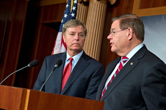 Sen. Lindsey Graham, R-S.C., a member of the Senate Armed Services Committee and Homeland Security Committee, left, joins Sen. Robert Menendez, D-N.J., right, a member of the Senate Foreign Relations Committee, on Capitol in Washington, Thursday, Nov. 29, 2012, to tell reporters they will push for a vote in Congress to kick the Palestinian Liberation Organization out of its Washington offices and withhold U.S. financial aid if the Palestinians seek to use an enhanced U.N. status against Israel. (AP Photo/J. Scott Applewhite)