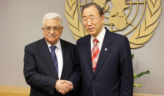 U.N. Secretary-General Ban Ki-moon (right) shakes hands with Palestinian President Mahmoud Abbas at U.N. headquarters on Wednesday, Nov. 28, 2012. (AP Photo/Frank Franklin II)